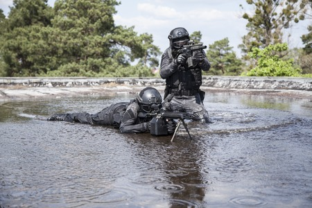 anti terrorist: Spec ops police officers SWAT in action in the water Stock Photo