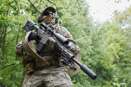sof: Green Berets US Army Special Forces Group sniper in action Stock Photo