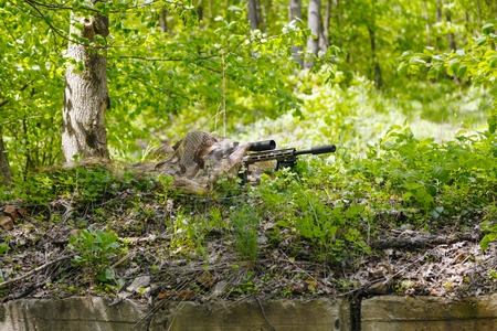 recon: Green Berets US Army Special Forces Group sniper in action Stock Photo