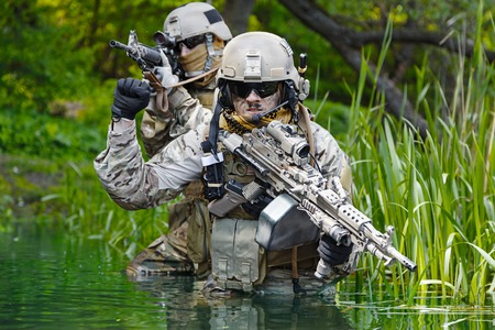 dirt: Green Berets US Army Special Forces Group soldiers in action