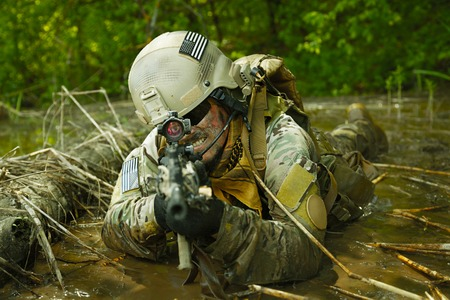 berets: Green Berets US Army Special Forces Group soldier in action
