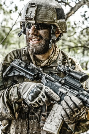 dirt: Green Berets US Army Special Forces Group soldier in action