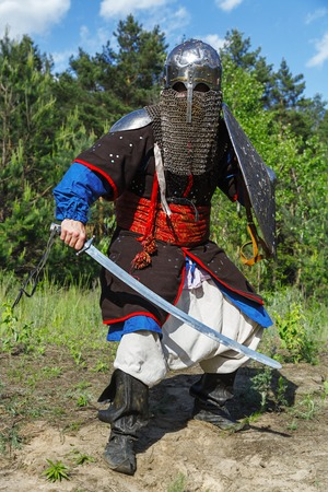 weaponry: Mongol horde warrior in armour holding traditional saber