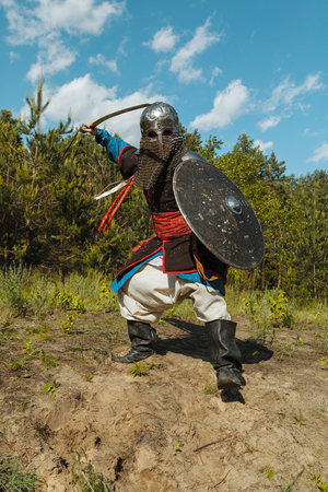 mongol: Mongol horde warrior in armour holding traditional saber