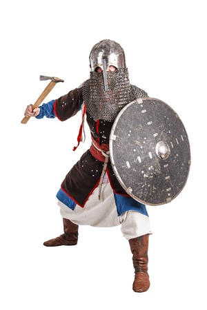 Mongol horde warrior in armour holding traditional axe Stock Photo