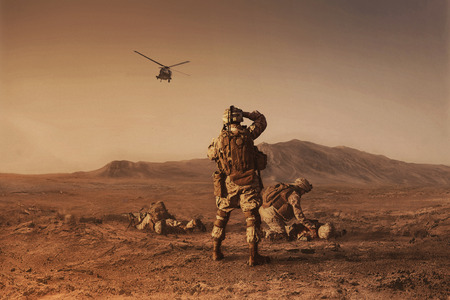 Squad of US marines waiting for medevac bird Archivio Fotografico