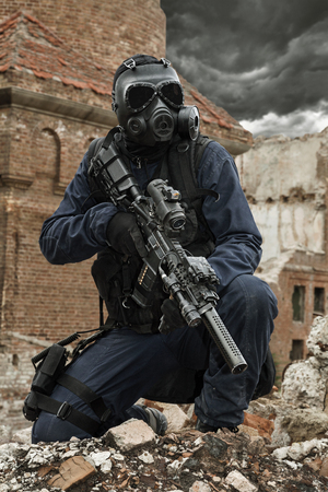 survivor: Post apocalypse. Sole survivor in tatters and gas mask on the ruins of the destroyed city Stock Photo