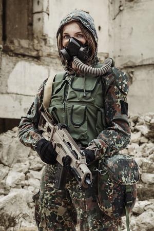 post apocalypse: Post apocalypse. Female survivor in gas mask Stock Photo