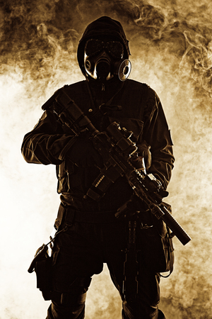 post apocalypse: Nuclear post apocalypse. Studio shot of survivor with weapons and gas mask