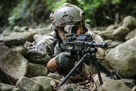 gi: United states army ranger machine gunner in the forest