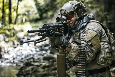 operator: United states army ranger machine gunner in the forest
