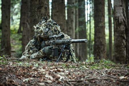 assault rifle: United states army ranger sniper wearing ghillie suit