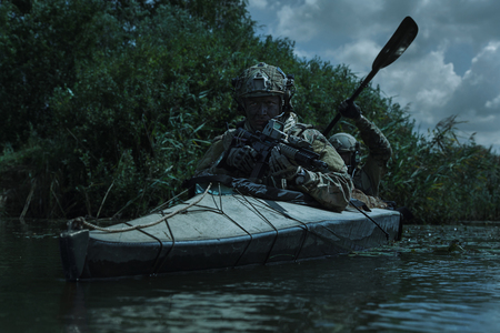 gi: Special forces operators in the military kayak
