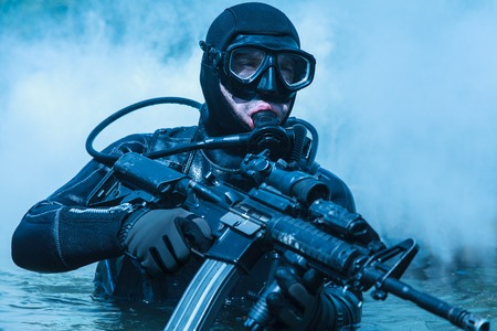 gi: Navy SEAL frogman with complete diving gear and weapons in the water