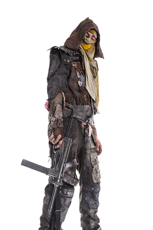 Nuclear post apocalypse life after doomsday concept. Grimy survivor with homemade weapons. Studio closeup portrait on white background Stock Photo