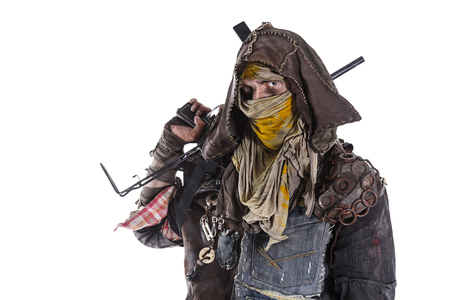 doomsday: Nuclear post apocalypse life after doomsday concept. Grimy survivor with homemade weapons. Studio closeup portrait on white background Stock Photo