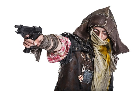 post man: Nuclear post apocalypse life after doomsday concept. Grimy survivor with homemade weapons aiming a gun. Studio closeup portrait on white background