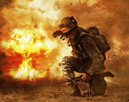 US soldier in the desert during the military operation turning to nuclear explosion mushroom cloud covering his eyes. He is doomed