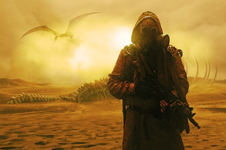 Nuclear post apocalypse. Life after doomsday concept. Grimy survivor with homemade weapons and gas mask. Desert and dead wasteland on the background