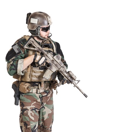 United states Marine Corps special operations command Marsoc raider with weapon. Studio shot of Marine Special Operator white background Stock Photo