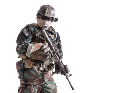 United states Marine Corps special operations command Marsoc raider with weapon. Studio shot of Marine Special Operator white backgroun Stock Photo