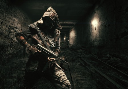 Nuclear post apocalypse. Underground life after doomsday in abandoned subway tunnels. Grimy survivor with homemade weapons