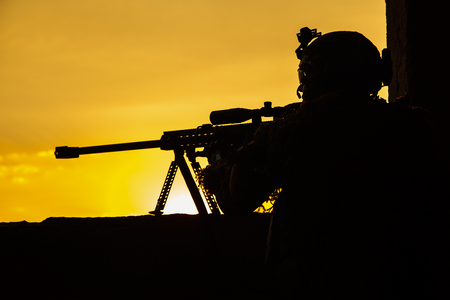 Army Sniper With Large Caliber Sniper Rifle Seeking Killing Enemy