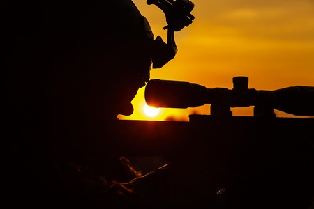 Special forces sniper large-caliber rifle seeking killing enemy. Closeup silhouette sky background. National security ensured, servicemen on guard