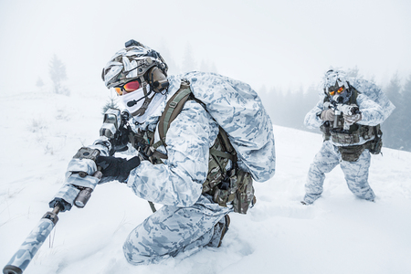 Winter arctic mountains warfare. Action in cold conditions. Pair of special forces weapons in forest somewhere above the Arctic Circle Stok Fotoğraf