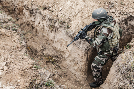 Paratrooper of french 1st Marine Infantry Parachute Regiment RPIMA in entrenchments, top view from above