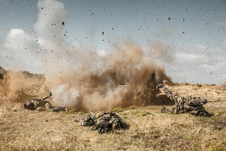 shockwave: Squad of elite french paratroopers of 1st Marine Infantry Parachute Regiment RPIMA ambushed in action, landmine exploding, they are killed Stock Photo