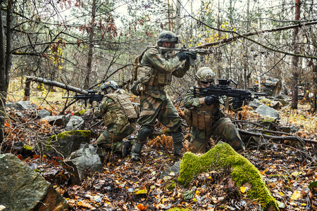 Norwegian Rapid reaction special forces FSK soldiers in field uniforms in action in the forest among the rocks
