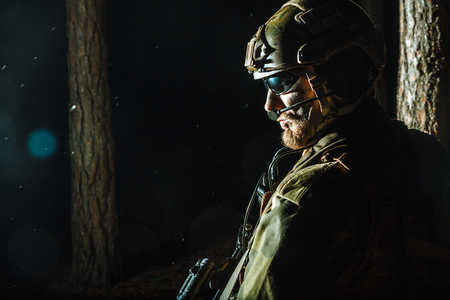 Image of soldier in the forest. Back light, cropped, toned and colorized