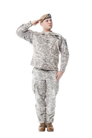 National Anthem is played. Army Ranger from Special Troops Battalion in universal Camouflage pattern Uniforms and Tan beret with Ranger Regiment crest is standing to attention and saluting proudly with honor and respect. Service to his country concept. Na