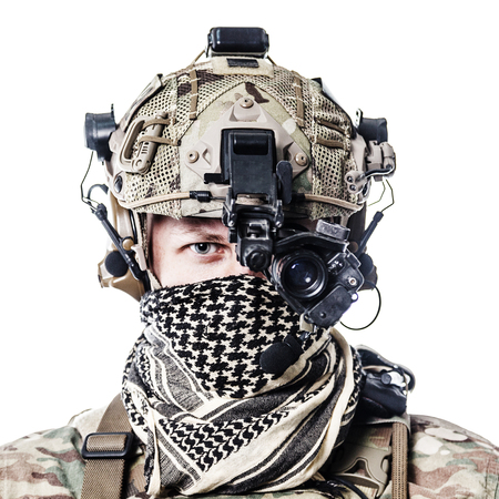 Army Ranger in field Uniforms with weapon, plate carrier and combat helmet are on, his face closed by Shemagh Kufiya scarf. Studio shot Imagens