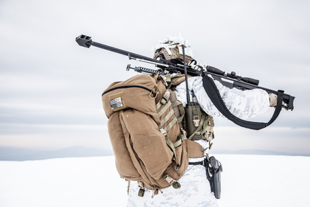 Army soldier with Sniper rifle in action in the Arctic. Back view