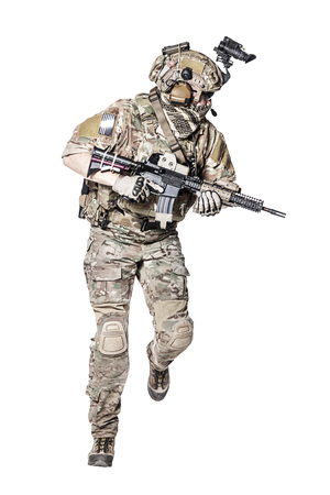 his shirt sleeves: Elite member of US Army rangers in combat uniforms with his shirt sleeves rolled up, in helmet, eyewear and night vision goggles, running in action turning around. Studio shot, white background
