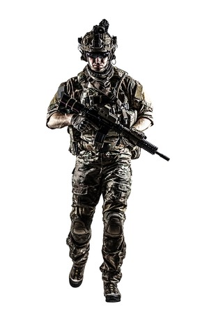 his shirt sleeves: US Army rangers in combat uniforms with his shirt sleeves rolled up, in helmet, eyewear and night vision goggles moving walking towards camera. Studio shot, white background, dark contrast