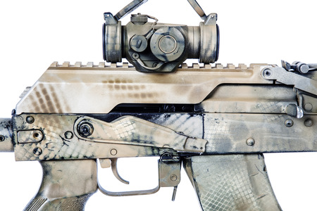 Close-up shot of   rifle receiver cover with collimator, automatic weapons isolated on white background. Gun is painted desert camouflage
