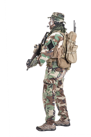 Special forces United States in Camouflage Uniforms studio shot. Holding weapons, wearing jungle hat, Shemagh scarf, painted face, his outfit clothes designed for jungle warfare. Studio shot isolated Stok Fotoğraf