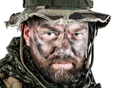 Special forces United States in Camouflage Uniforms studio shot. Wearing jungle hat, Shemagh scarf, painted face. Studio shot isolated Stock Photo