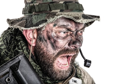 United States Commando face studio shot. Mouth opened, soldier yelling, emitting intiminate formidable frightening scream. Closeup portrait, cropped, isolated