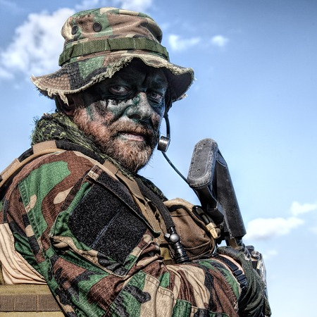 Bearded soldier of special forces on blue sky background Stock Photo