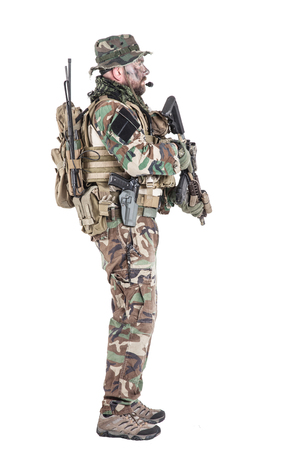 Special forces United States in Camouflage Uniforms studio shot. Holding weapons, wearing jungle hat, Shemagh scarf, painted face, his outfit clothes designed for jungle warfare. Studio shot isolated Stock Photo