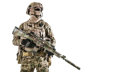 Half length low angle studio shot of special forces soldier in field uniforms with weapons, portrait isolated on white background. Protective goggles glasses are on Reklamní fotografie
