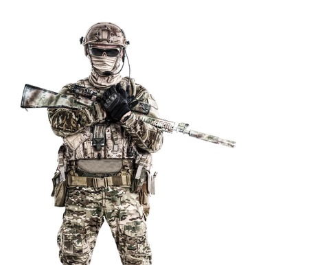 Half length low angle studio shot of special forces soldier in field uniforms with weapons, portrait isolated on white background. Protective goggles glasses are on Stock Photo