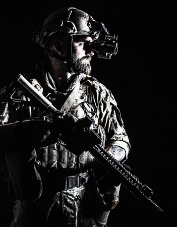 Studio contour backlight shot of special forces soldier in uniforms with weapons, portrait on black background Stok Fotoğraf