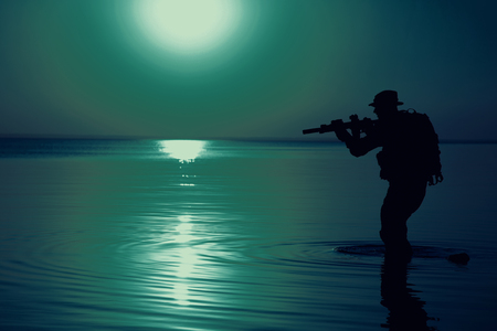 Army soldier with rifle night moon silhouette under cover of darkness. Covert diversionary operation
