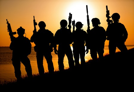 Army soldiers with rifles orange sunset silhouette Stok Fotoğraf - 88039857