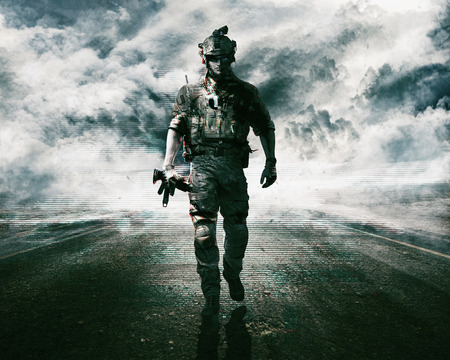 Army soldier moving towards camera on cloudscape background Stok Fotoğraf